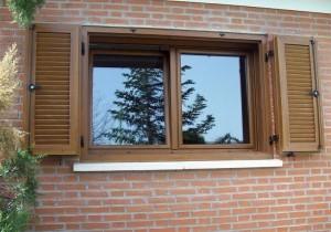ventana de pvc y contraventa de pvc en imitacion madera